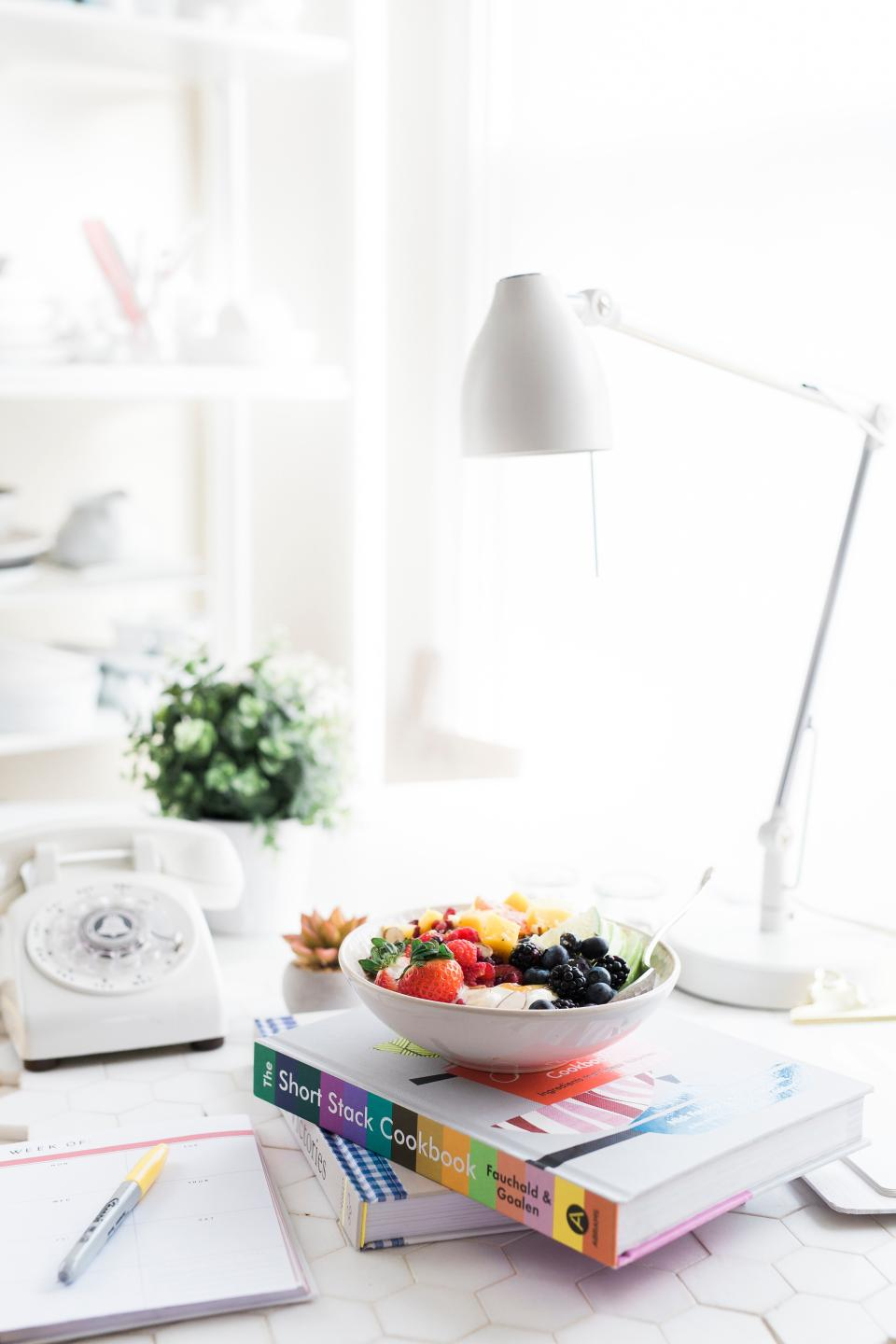 fruits food dessert sweets book notebook pen table white lamp interior design