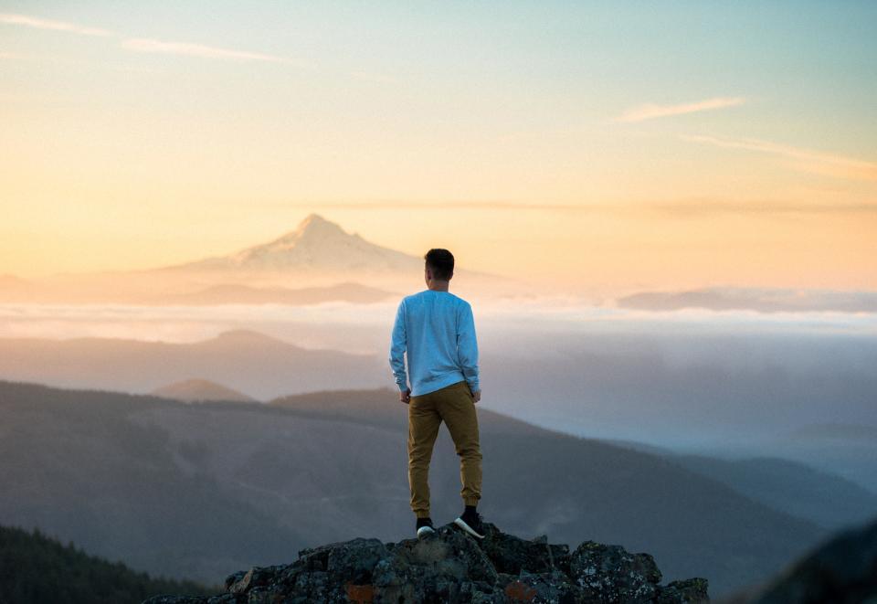 people man back mountain peak summit adventure travel trip hiking climbing view clouds mountaineer nature