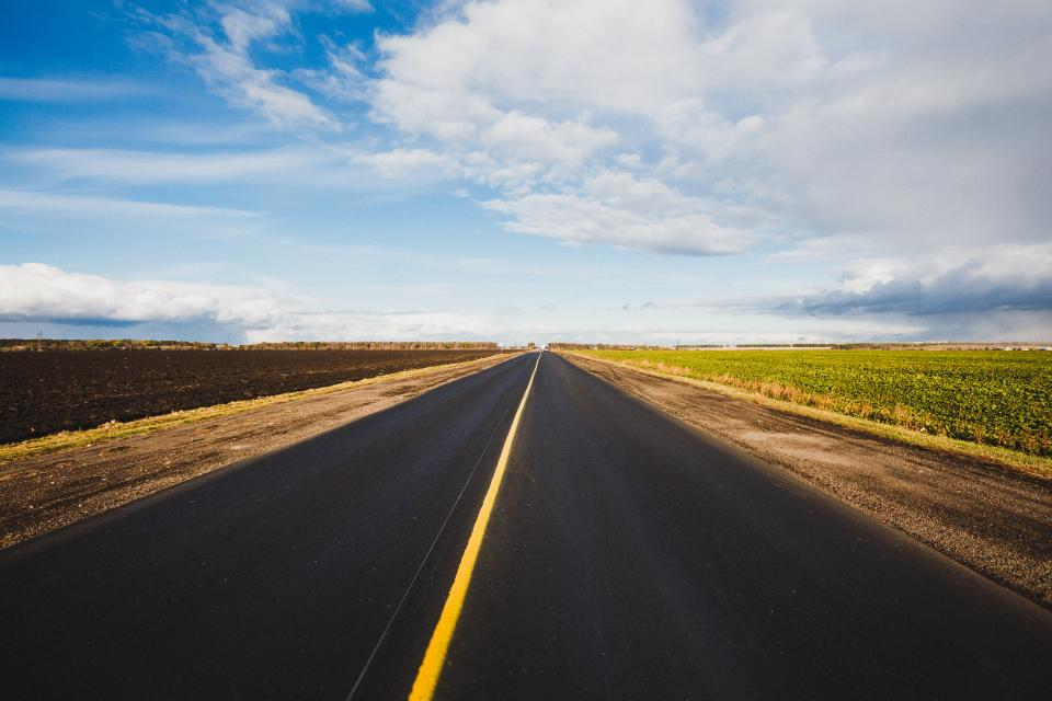 nature landscape road highway travel adventure field green grass clouds sky