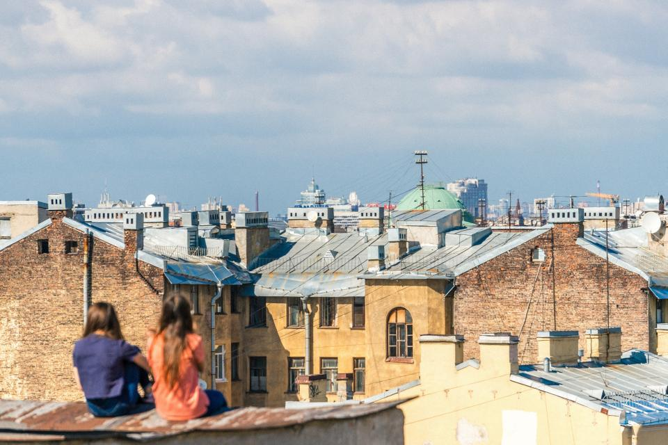 people girl friend talking rooftop houses village buildings blue sky cloud sunny day