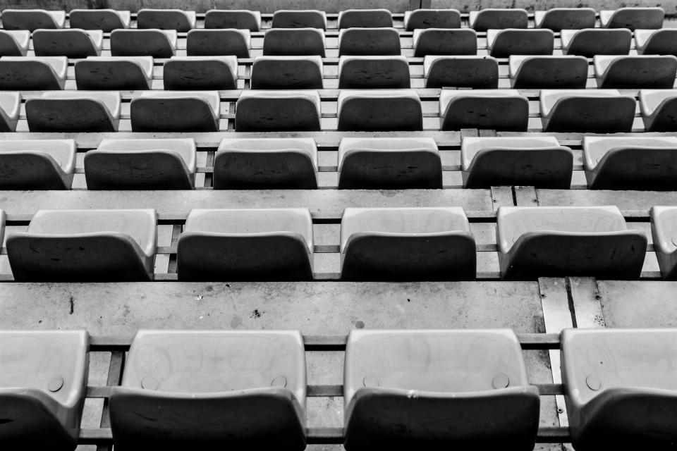 seats chairs stadium rows event black and white