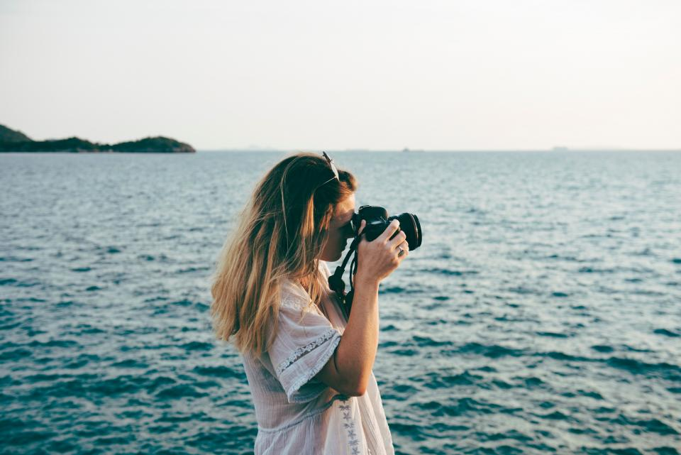 people woman girl sea ocean water travel horizon camera photographer outdoor