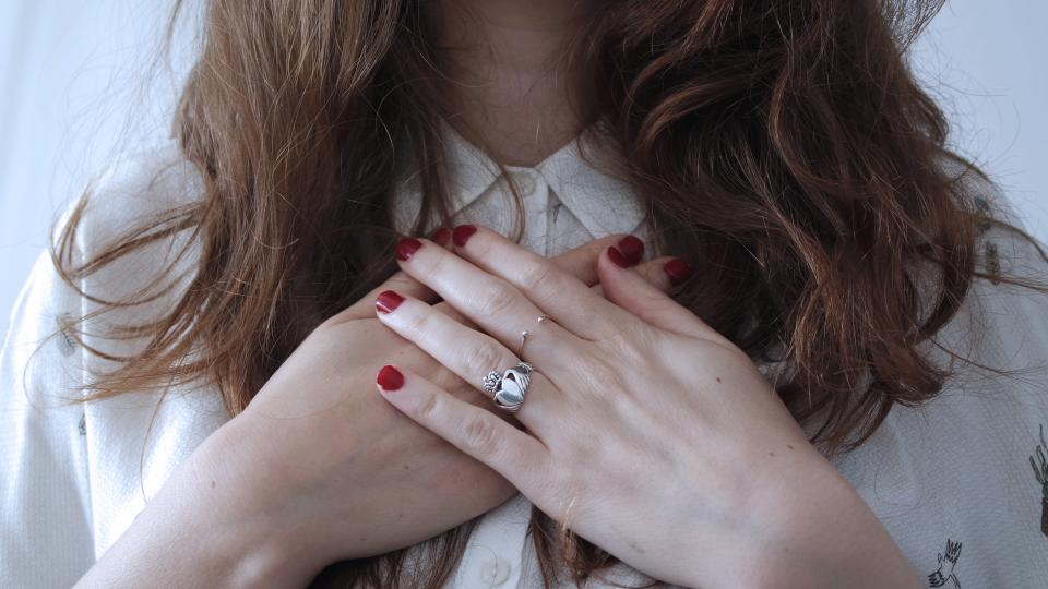 hands chest girl people fingers ring hair bracelet nail polish red
