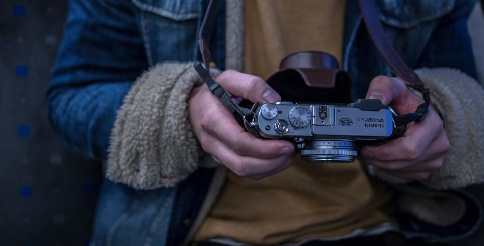 hands man boy camera fujifilm lens photo jacket fur strap