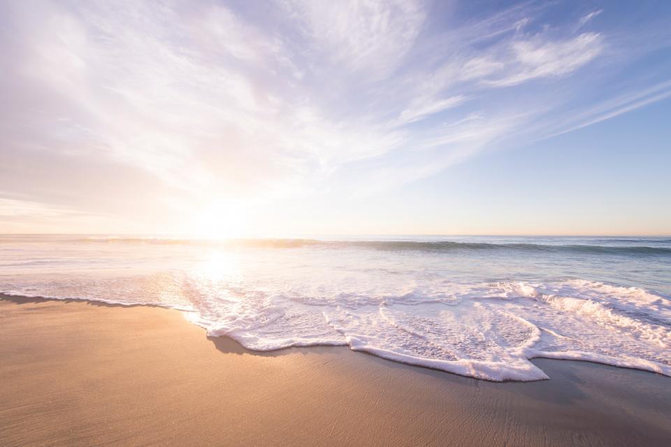 beach shore coast water sea ocean sky clouds sunrise sunset sunlight waves nature