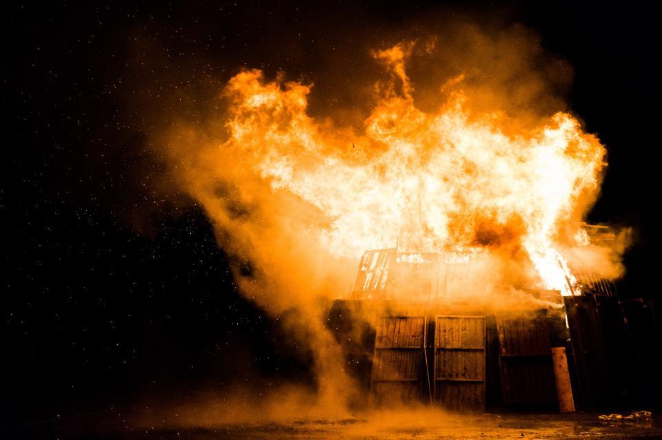 fire flames smoke burning night dark wood building
