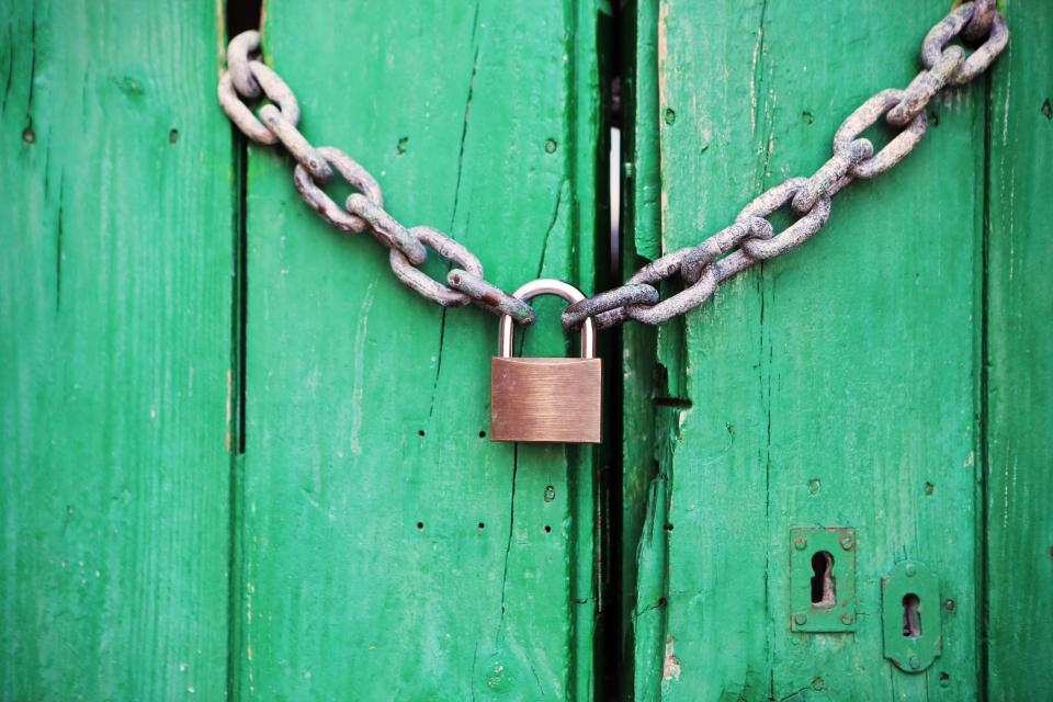 chain links padlock wood gate keyhole