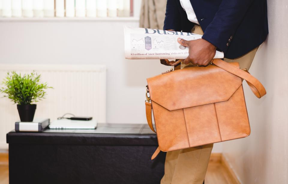 guy man business newspaper leather bag suitcase briefcase suit work office people