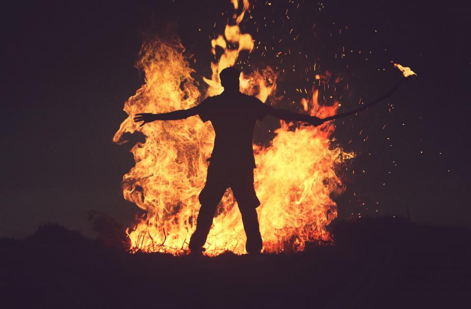 fire flame bonfire dark night heat firewood light people man guy alone silhouette