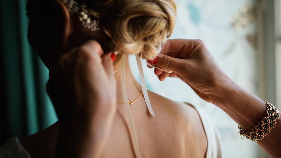 people woman girl back hairstyle wedding necklace bracelet