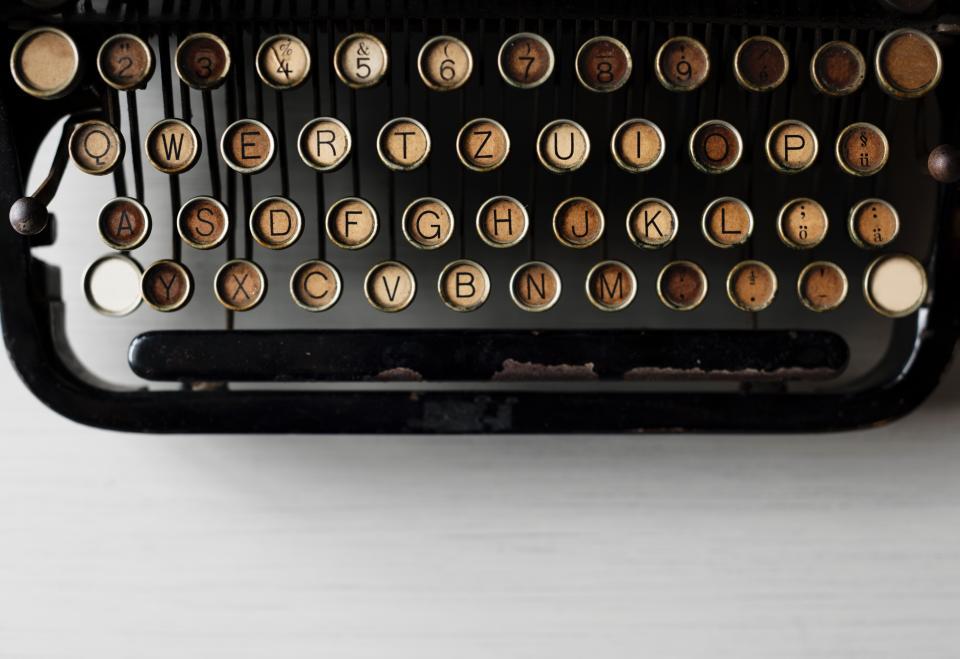 typewriter electromechanical machine work desk office