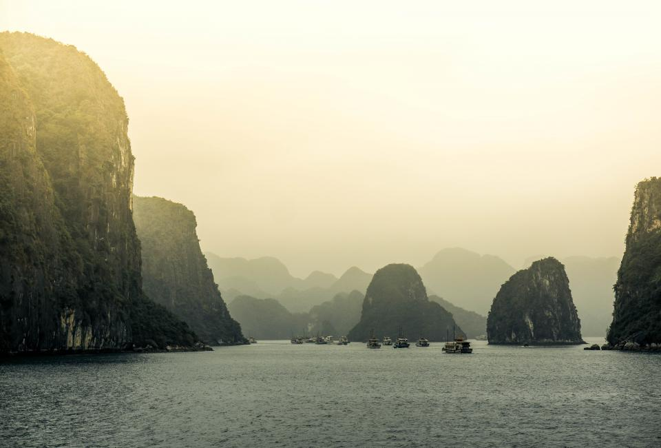mountain highland cliff fog sea ocean water nature boat travel adventure view