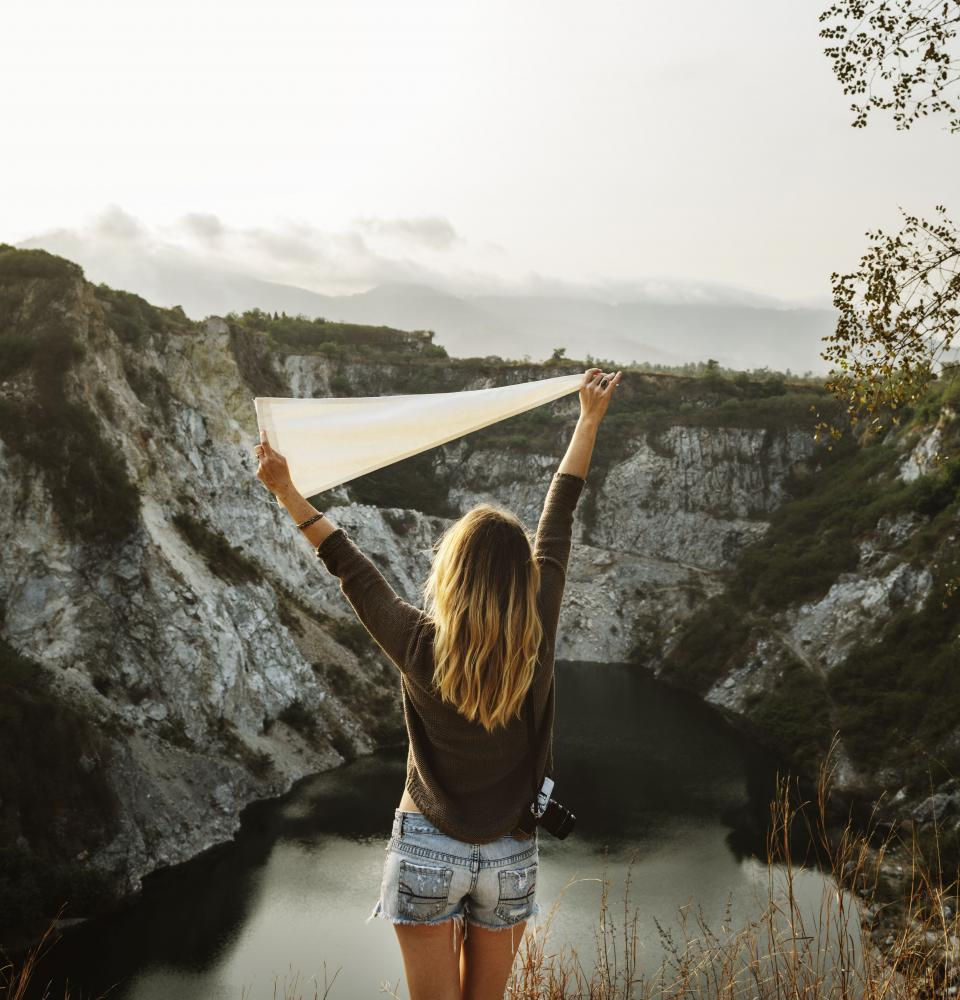 mountain highland sky landscape view lake water peak nature green grass rocks trees plant people travel outdoors girl lady female happy
