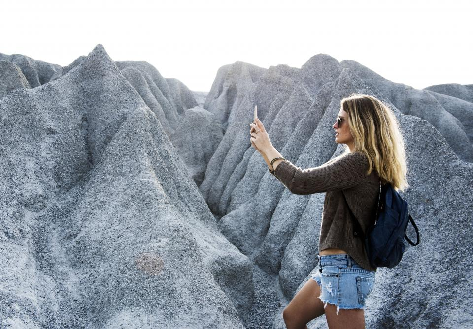 people girl female lady woman millennials rocks mountain hill cliff selfie mobile phone camera photography travel outdoor adventure