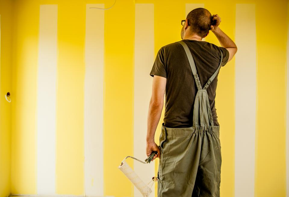 guy man painting brush roller overalls construction renovations repair house home walls people