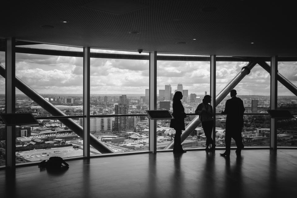 office work business conference area meeting perspective pattern windows floor ceiling city buildings urban workmates mates view sky clouds