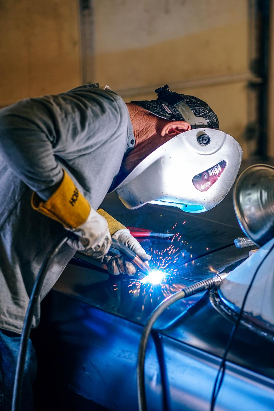 people man work welder welding metal