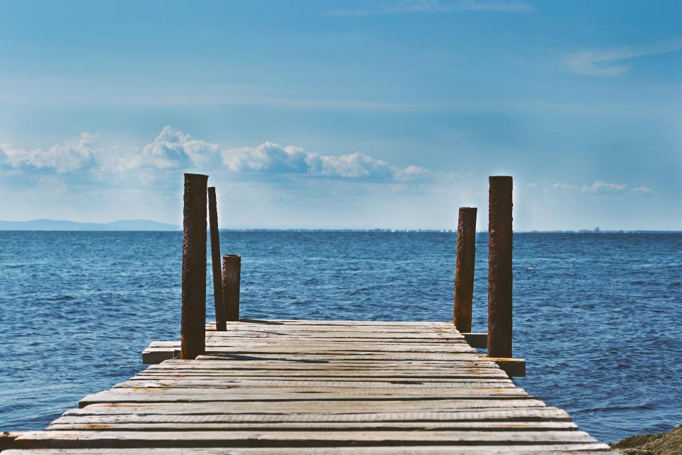 dock lake water blue sky clouds sunshine outdoors summer sea