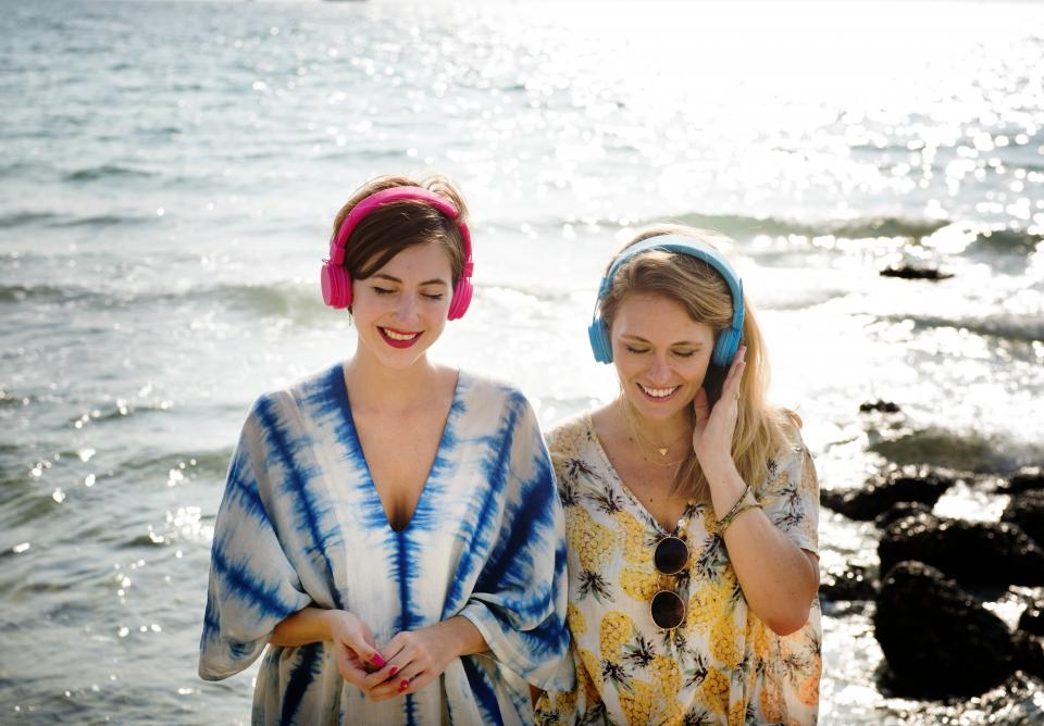 girls women people friends smile smiling happy headphones music beach ocean summer shore listening