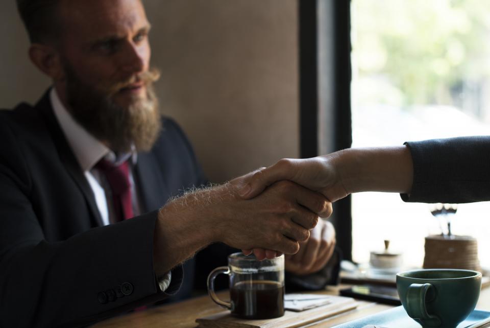 restaurant cafe coffee drink handshake holdin hands business man meeting