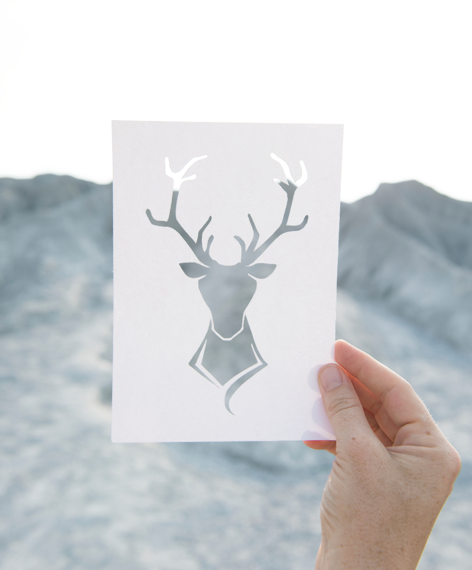 craft mountain holding paper tranquil scene wildlife travel recreation hiking hand antlers animal deer abstract hill icon wild paper craft peaceful symbol art moose leisure serene peace background perforated rest