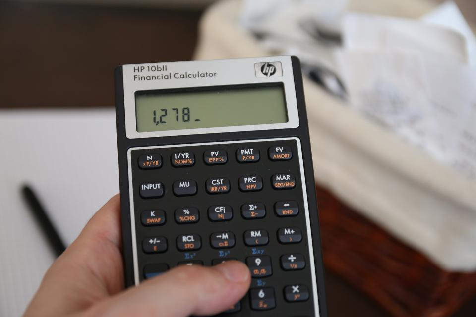 calculator math finance school education work business numbers hands accounting
