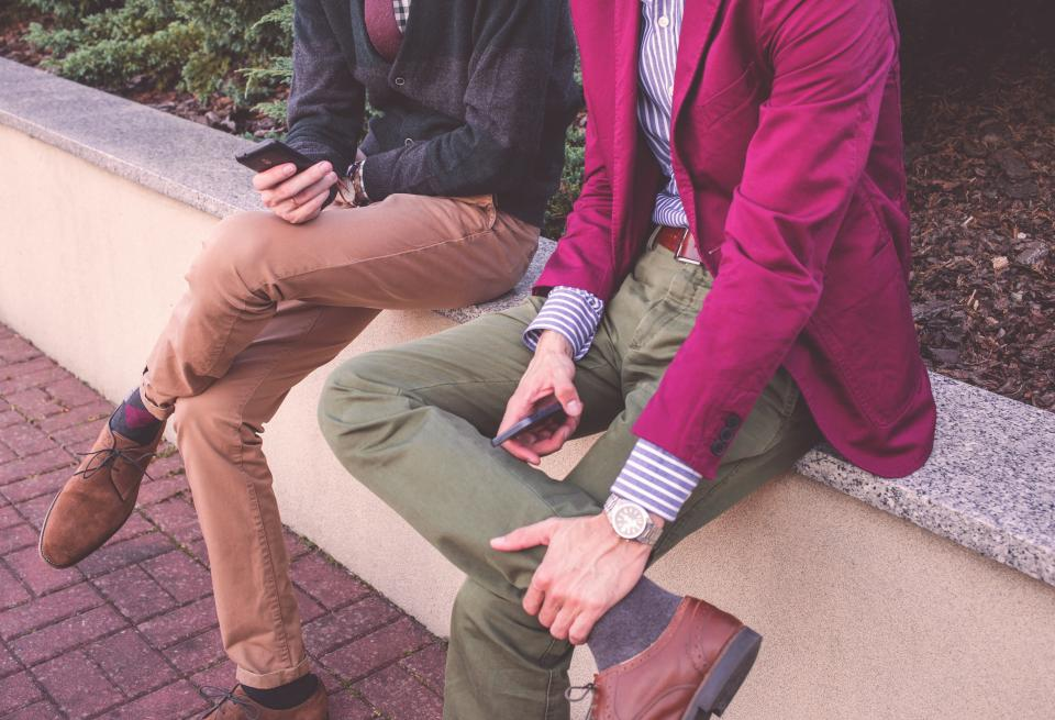 guy man men people clothes clothing fashion blazer pants shoes friends texting mobile smartphone sitting sidewalk