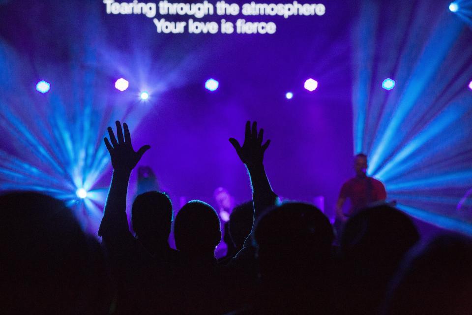 concert singer singing stage lights spotlight people rock music band musician guitarist crowd silhouette purple