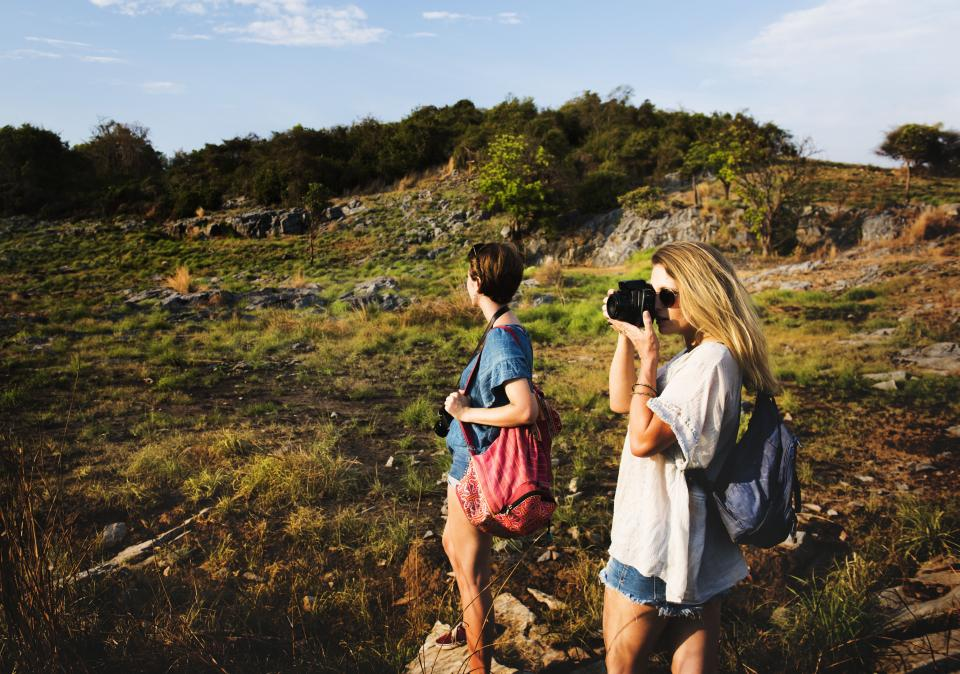 mountain highland blue sky landscape view nature green grass rocks trees plant travel outdoors people friends girl women photographer camera
